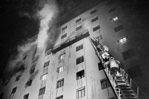 JACK SCHAEFER / ARIZONA DAILY STAR 1970 Firefighters at the Pioneer Hotel fire bring down some of the survivors on an extended ladder. Many hotel guests weren't as lucky and died jumping from windows of the 11-story hotel.