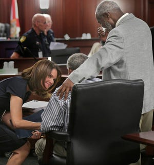 Florida State attorney talks with her clients after their 1976 murder convictions were overturned.