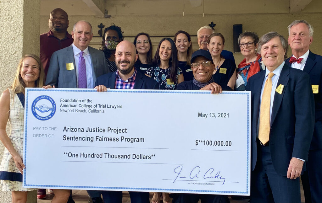 Arizona Justice Project staff, board members, volunteers, freed clients, and Arizona College of Trial Lawyers Fellows gathered at the University Club of Phoenix on May 13, 2021 for a check presentation for the Emil Gumpert Award.